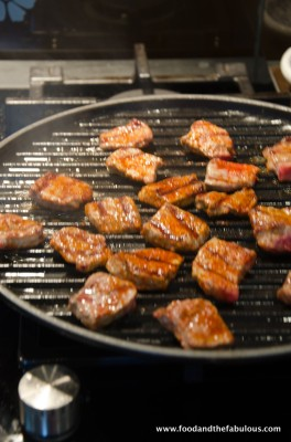 meat on griddle pan cooking
