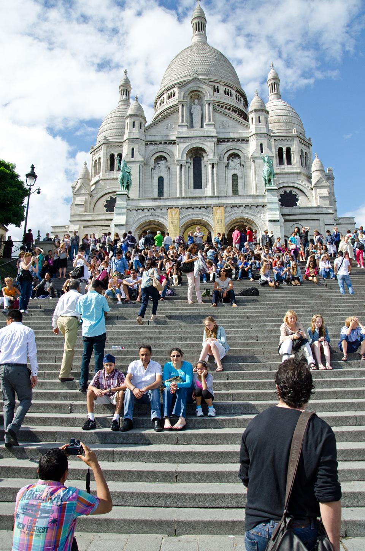 on the steps outside the Sacré-Coeur