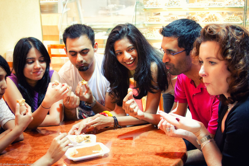 Enjoying manousheh at our Lebanese bakery stop. Image: Airspective media