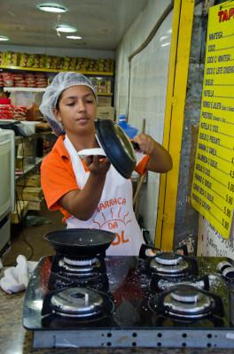 vendor making tapioca pancakes