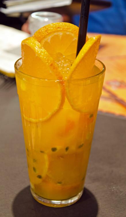 Tangerine and passion fruit caipirinha at http://bardadonaonca.com.br/
