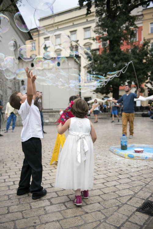 children delight over bubbles at Krakow main square