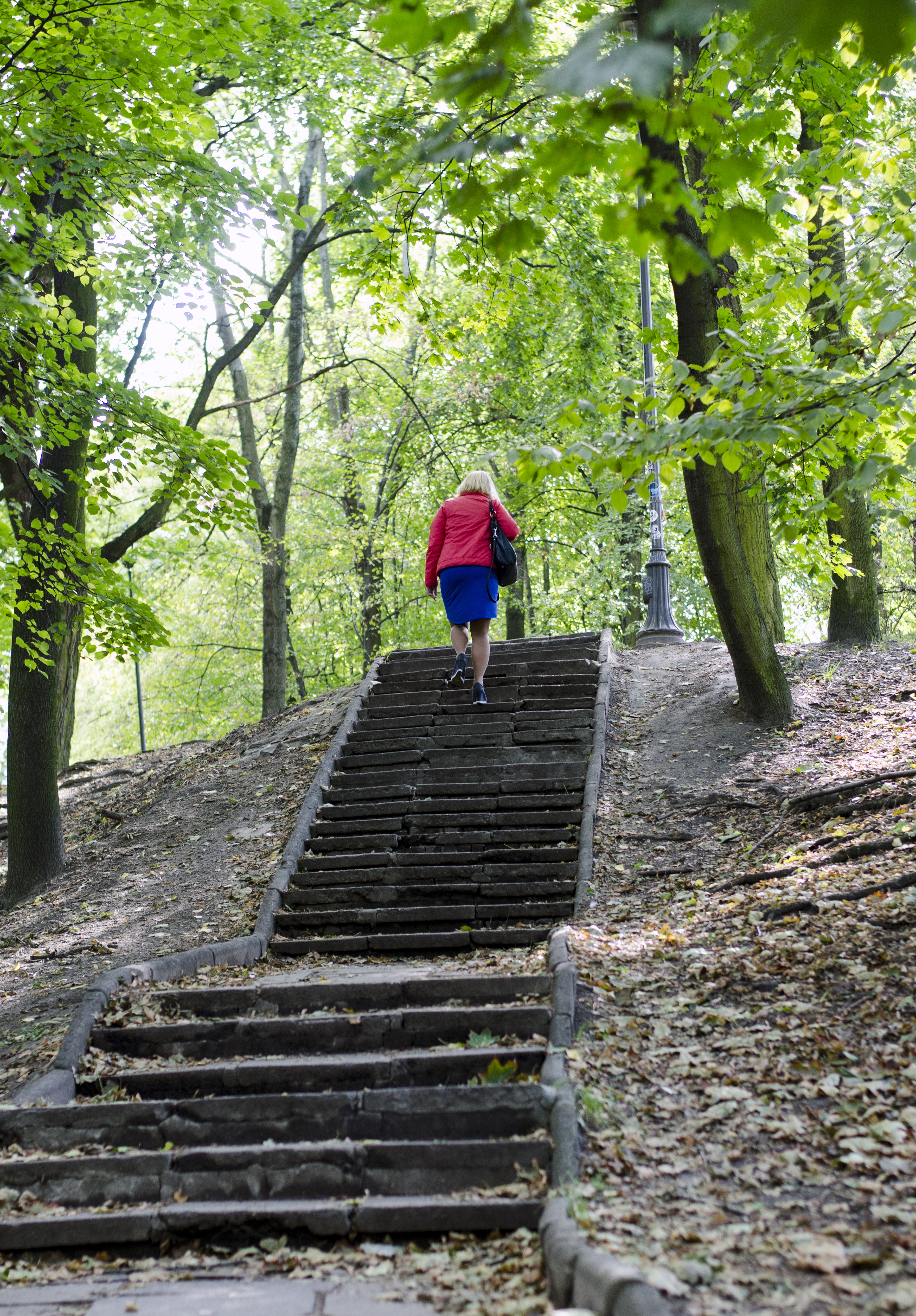 woman walking up stairs in park