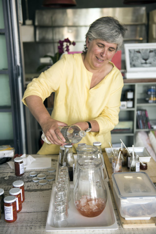 Loubie pouring her cordials