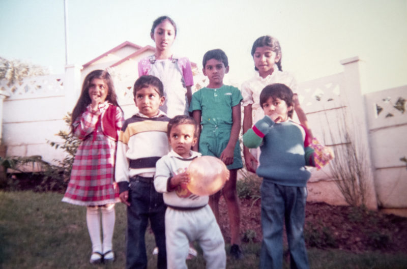 author with neighburhood kids in the 80s