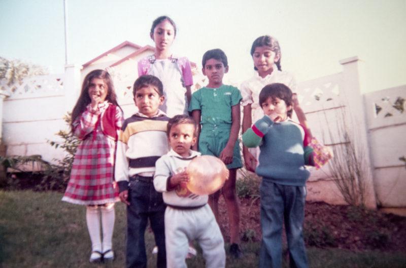 author with neighburhood kids in the 80s