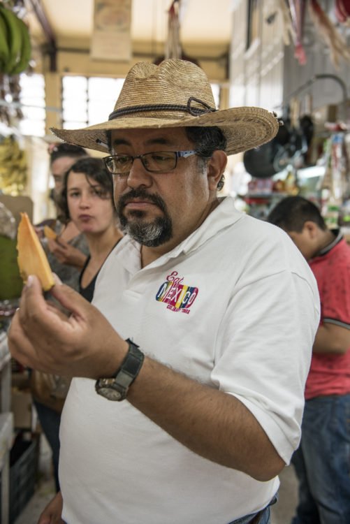 guide taking us through a tasting of Mexican fruit at a local market