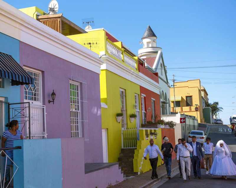 History, colour and tradition meet in the Bo-Kaap as a bridal couple walk down the road.  Hello! @ishaygovender here with the weekend takeover. Looking forward to sharing a slice of culture, food and the beautiful Cape with you. Image: Ishay Govender 📸
