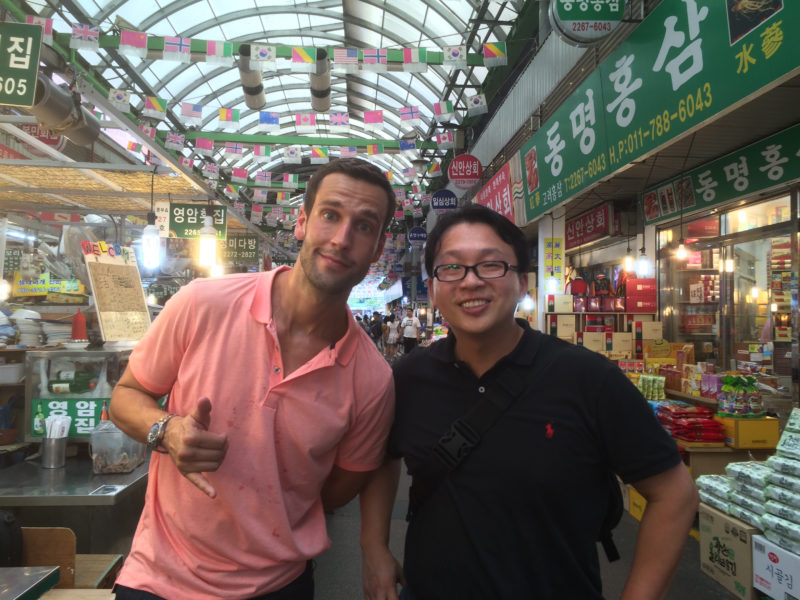 Daniel Gray (right) with client on a food tour. Image supplied